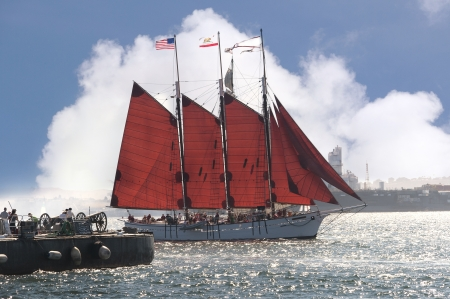 Cannons firing in mock sea battle with Tall Sailing Ships in Harbour of San Diego California USA photo