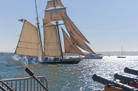 Cannons firing in mock sea battle with Tall Sailing Ships in Harbour of San Diego California USA Editorial