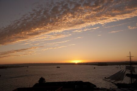Sunset over the Tall Ships in San Diego California USA photo