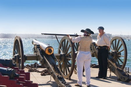 Musket firing in mock sea battle with Tall Sailing Ships in Harbour of San Diego California USA photo