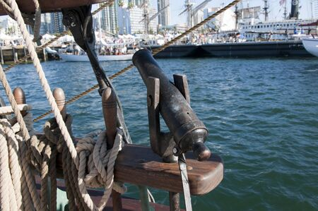 Small Signal Gun on Tall Sailing Ship in Harbour of San Diego California USA photo