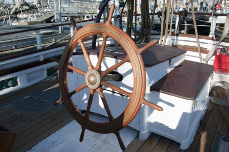 Ships Wheel on Tall Sailing Ship in Harbour of San Diego California USA photo