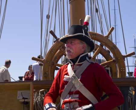 Re-enactor Marine on the Tall Sailing Ships in Harbour of San Diego California USA