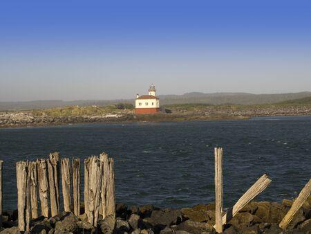 capes: Lighthouse on the Coast of Oregon Near Coos Bay USA