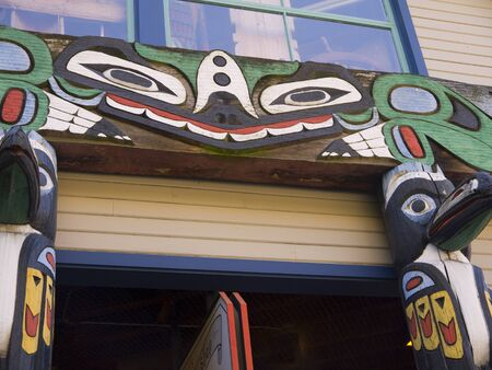 totem poles on Quayside in Seattle Washington USA