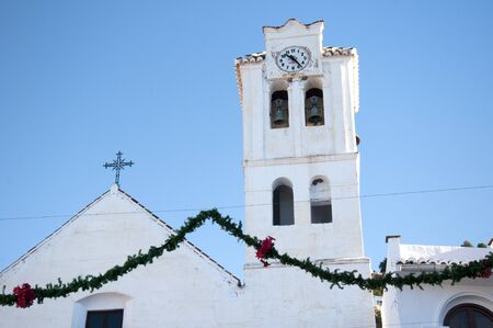 The Church in Frigiliana one of the White Villages in Andalucia Spain photo