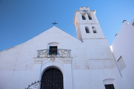 alpujarra: The church in Frigiliana one of the White Villages in Andalucia Spain Stock Photo