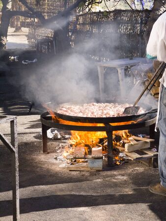 Cooking a gigantic paella on the beach at Nerja Andlucia Spain Stock Photo - 17317685