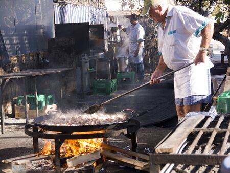 Cooking a gigantic paella on the beach at Nerja Andlucia Spain
