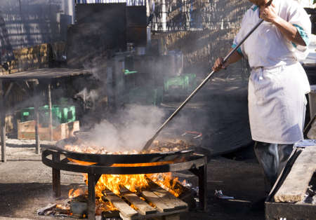 Cooking a gigantic paella on the beach at Nerja Andlucia Spain Stock Photo - 17317668