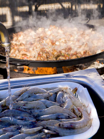 Cooking a gigantic paella on the beach at Nerja Andlucia Spain Stock Photo - 17317672