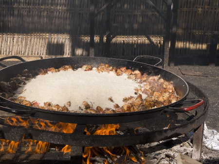 Cooking a gigantic paella on the beach at Nerja Andlucia Spain Stock Photo - 17346679