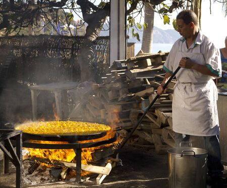 alpujarra: Cooking a gigantic paella on the beach at Nerja Andlucia Spain