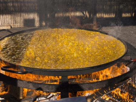 Cooking a gigantic paella on the beach at Nerja Andlucia Spain Stock Photo - 17346676
