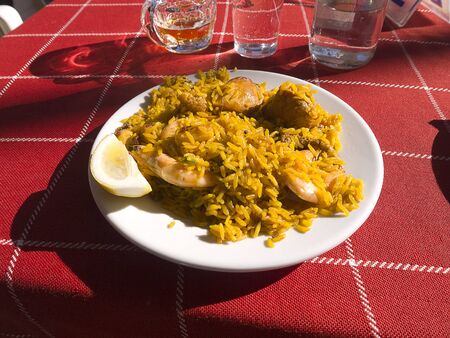 A Portion of paella on the beach at Nerja Andalucia Spain photo