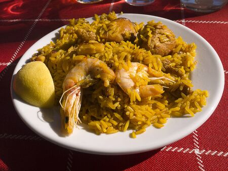 burriana beach: A Portion of paella on the beach at Nerja Andalucia Spain