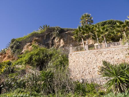 burriana beach: Cliffs behind the Burriana Beach in Nerja Andalucia Spain Stock Photo