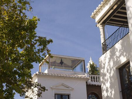 Building with decorated loggia in Nerja Spain photo