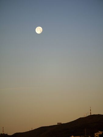 The Setting Moon in Nerja Andalucia Spain photo