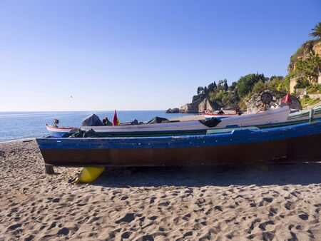 fishing boats on the Burriana Beach at Nerja Spain photo