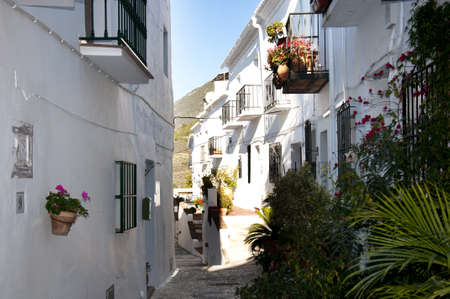 The narrow streets of Frigiliana one of the White Villages in Andalucia Spain photo