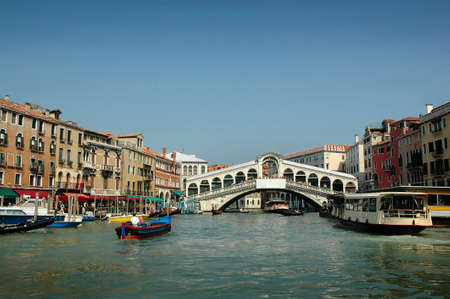 gondoliers: Rialto Bridge on Grand Canal  Every corner in Venice discloses a different face of the city  La Serenissima is beautiful at all times of the day