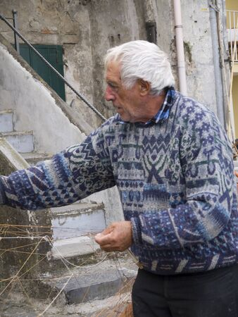 sorting out: Fisherman sorting out his nets in Sorrento Southern Italy