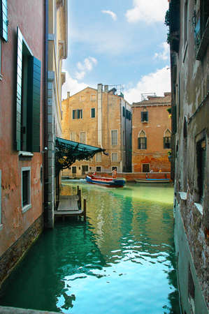 gondoliers: Quiet side canal in Venice Italy Stock Photo