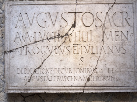 Plaque at Herculaneum celebrating Caesar Augustus in Italy