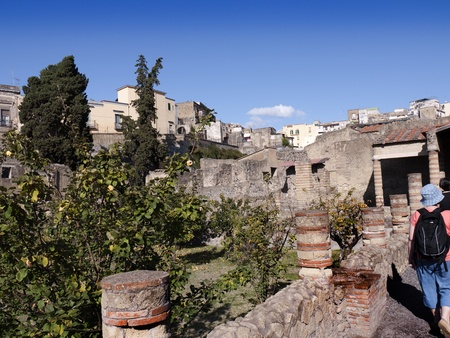 Walking through Herculaneum the Roman city buried by Vesuviusin Italy