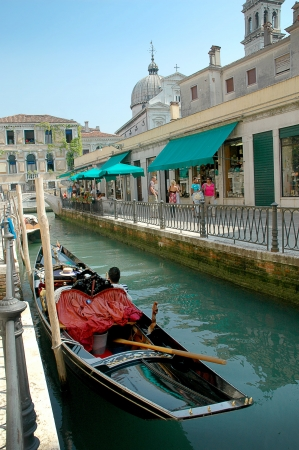 gondoliers: Every corner in Venice discloses a different face of the city. La Serenissima is beautiful at all times of the day. Editorial