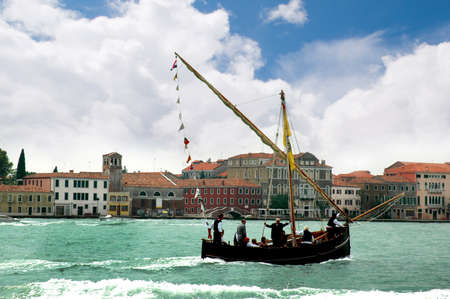 clock of the moors: Sailing ship with Lateen Sail in the Gesuiti Area of Venice Italy