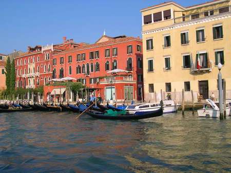 Gondolier and Gondola on the Grand Canal in Venice Italy Stock Photo - 18603674