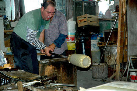 clock of the moors: Glass Blowers on the Island of Murano Italy Editorial