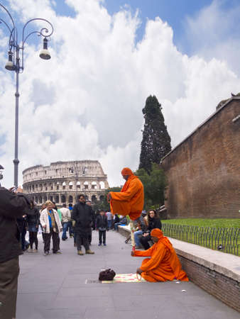 brenda kean: Buskers near the Colosseum in Rome Italy Editorial