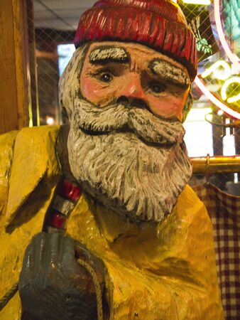 klondyke: Painted Wooden Statue of Fisherman in Seattle Washington USA