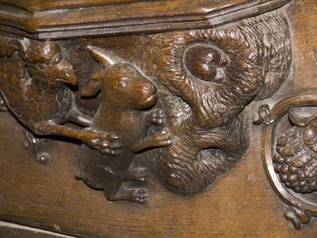 lewis carroll: Woodcarving in Ripon Cathedral in Yorkshire England of a rabbit gooing down a hole said to have inspired Alice in Wonderland