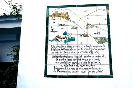 One of the old Ceramic Plaques telling the story of the Battle of Frigiliana in the Mountains of Andalucia in Spain Editorial
