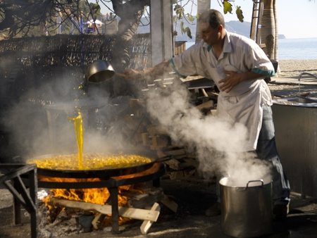 Cooking a gigantic paella on the beach at Nerja Andalucia Spain