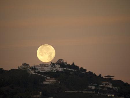 nerja: The Setting Moon in Nerja Andalucia Spain