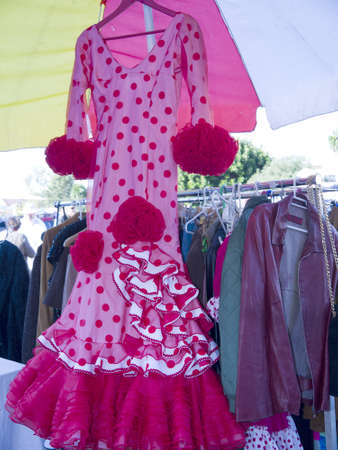 Flamenco dresses for sale on Nerja Market on the Costa Del Sol in Spain