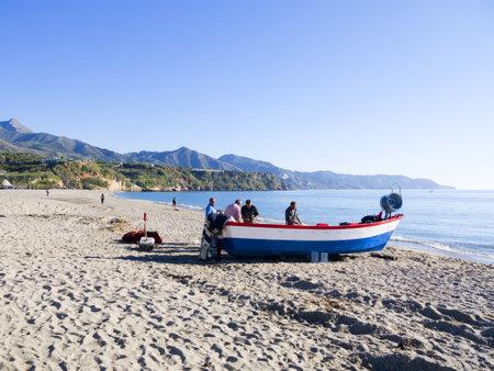 fishing boats on the Burriana Beach at Nerja Spain