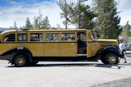 Old Autobus  by Old Faithful in Yellowstone National Park USA