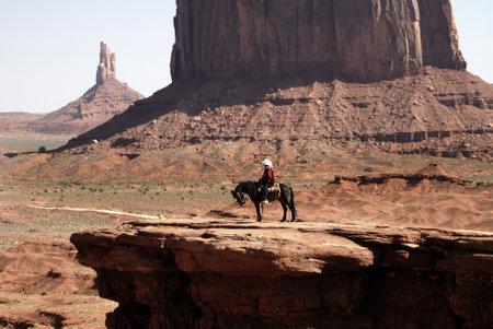 john wayne: Horse and rider in Monument Valley Navajo Nation Utah USA