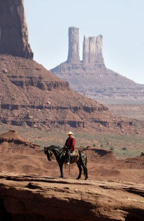 john wayne: horse and rider in Monument Valley Navajo Nation Utah USA Editorial