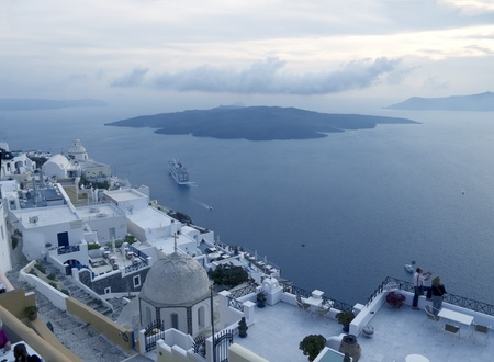 fira: Twilight falls over Fira on the island of Santorini Greece Editorial