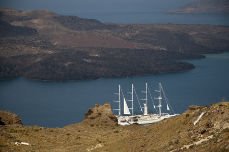 fira: View of Cruise Ships in the sea filled the Caldera below Fira the Capital of Santorini Greece