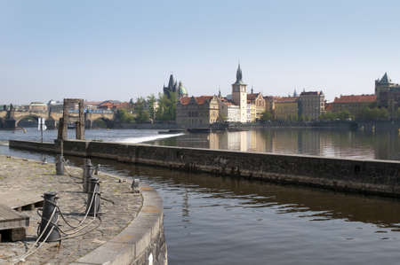 joins: Canal with Waterwheel joins the River Vltava in Prague the Capital of the Czech Republic, Europe Editorial