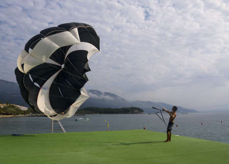 Getting a Parachute ready for work at Dassia Corfu Greece