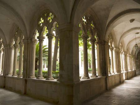 walled: Cloisters in Franciscan Monastery in the Walled City of Dubrovnic in Croatia Europe It is one of the most delightful tourist resorts of the Mediterranean. Dubrovnik is nicknamed Pearl of the Adriatic